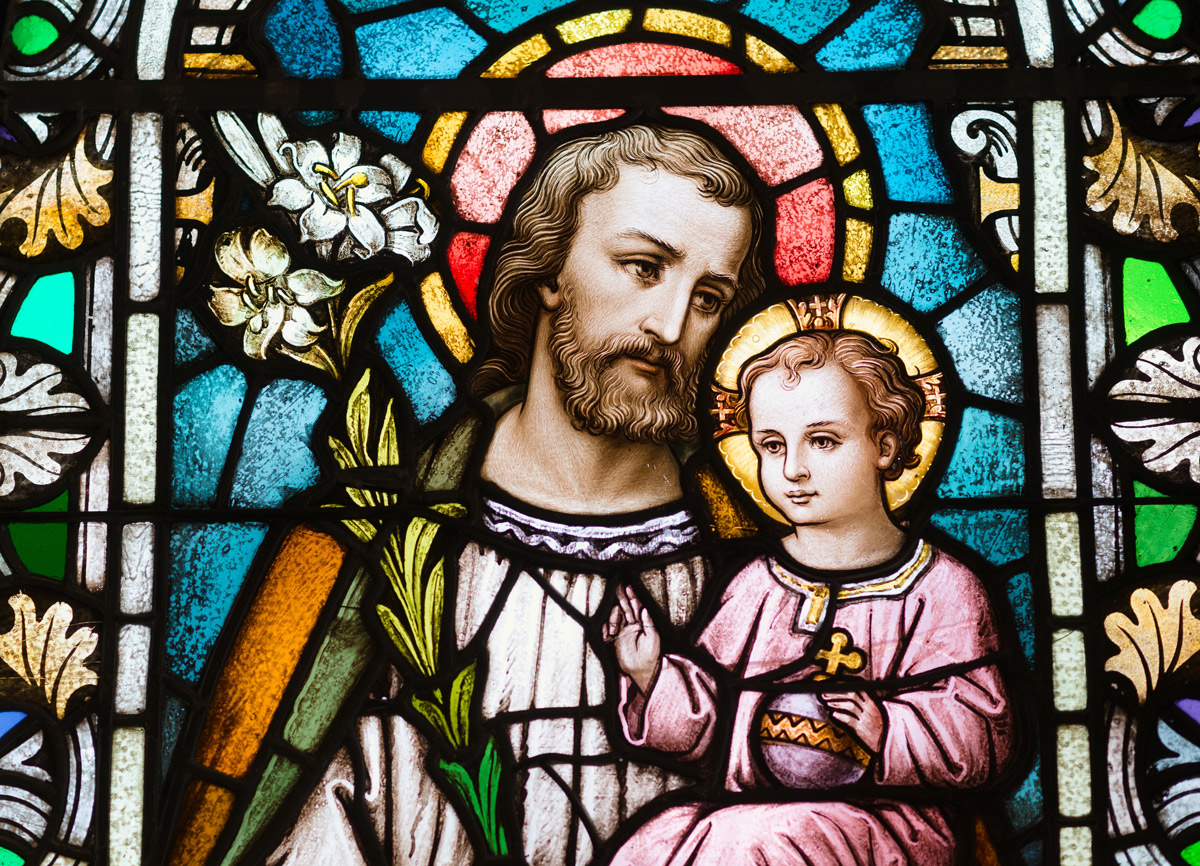 Stained glass window of St. Joseph are the Child Jesus