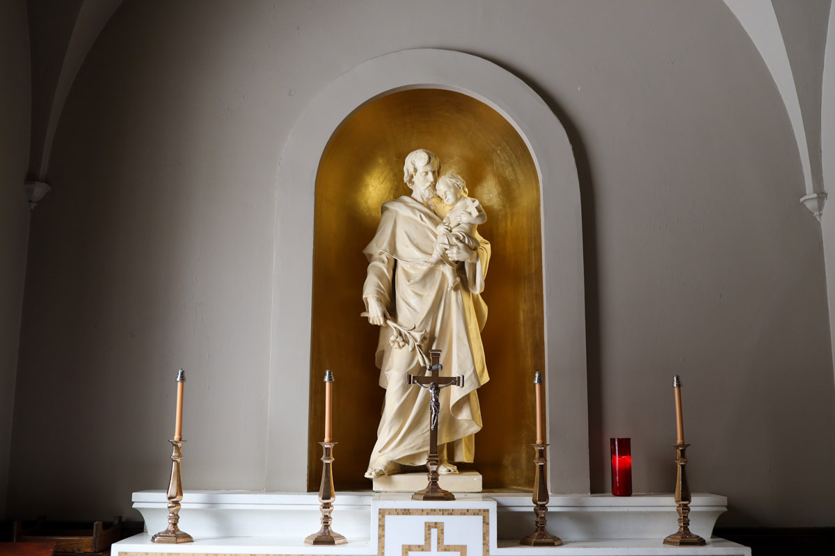 Altar with statue of St. Joseph holding the Child Jesus