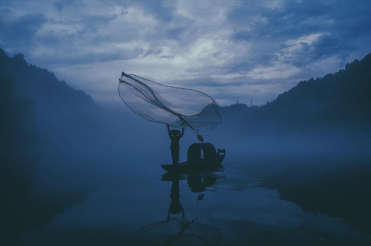 Fishermen casting a net